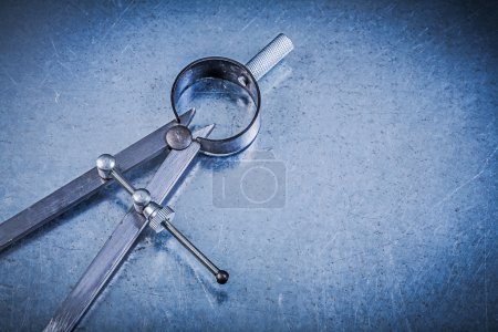 Photo for Metal construction drawing compass on metallic background - Royalty Free Image