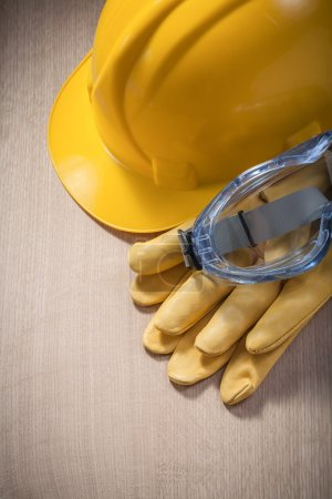 Hard hat, protective gloves and spectacles