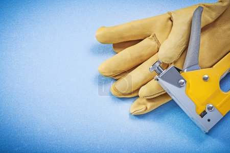 Leather protective gloves and construction stapler