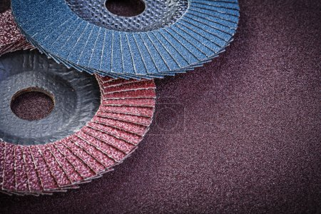Abrasive flap wheels on sandpaper
