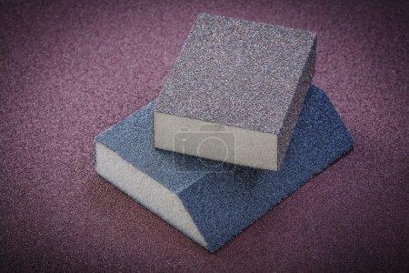 Sanding sponges on polishing paper abrasive materials