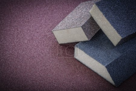 Sanding sponges on polishing sheet top view abrasive materials