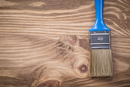 Paintbrush on wooden board copy space construction concept