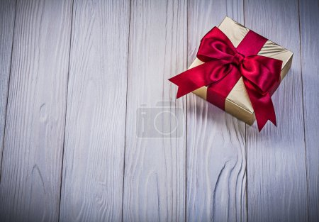 Wrapped giftbox on wooden board holidays concept