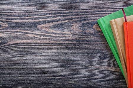 Pocket-books on vintage wooden board office concept