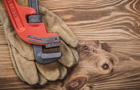 Protective gloves and pipe wrench