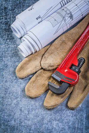 Pipe wrench and leather protective glove