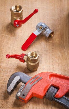 Monkey wrench and plumbing fixtures