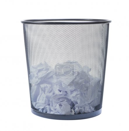Trash can filled with crumbled paper