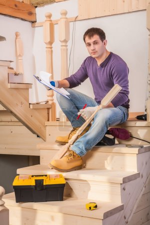 Carpenter on ladder