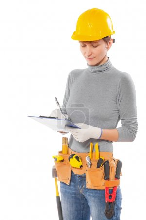 feamale worker with construction tools holding clipboard writing