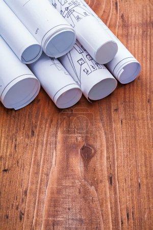 Blueprints on  wooden board