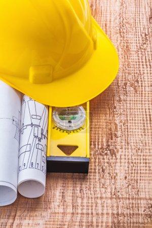 Blueprints and construction spirit level