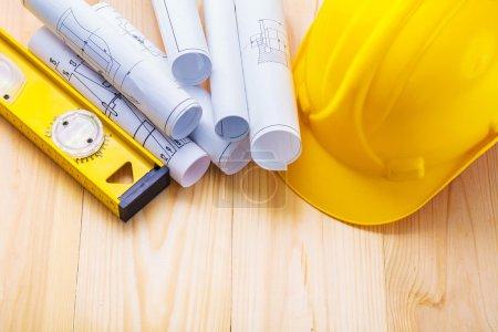 Blueprints with yellow helmet