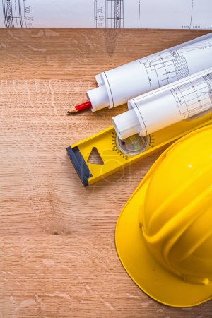 Construction concept with yellow hardhat