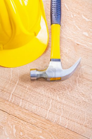 Yellow hardhat and claw hammer