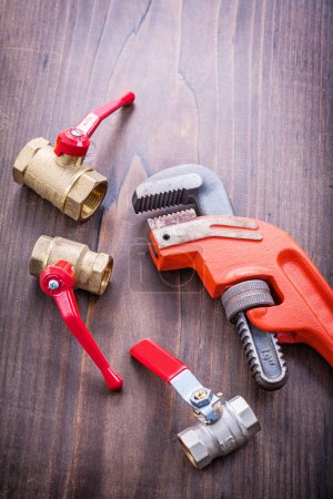 Plumbers fixtures and adjustable wrench