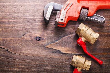 Plumbers tools on vintage wooden board