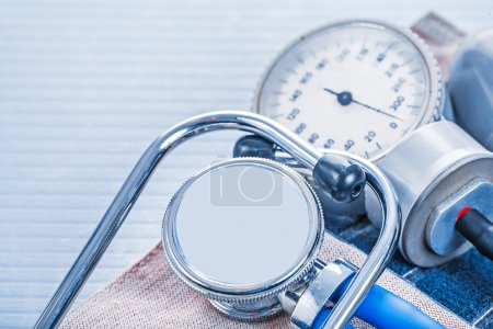 Stethoscope on blood pressure monitor