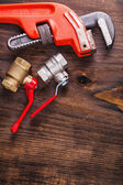 Two plumbers fixtures and monkey wrench