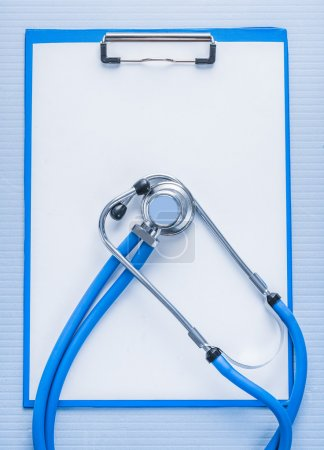 Stehoscope and clipboard, medical concept