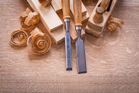 Chisels on wooden board