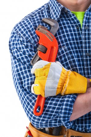 Construction worker holding monkey wrench