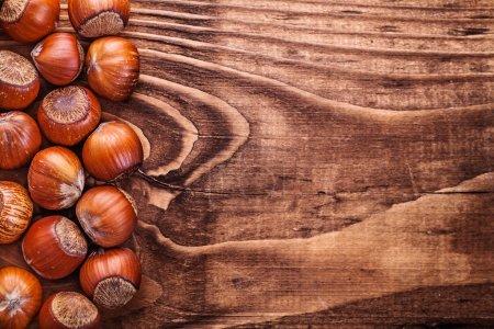 Hazelnuts on vintage wooden board food