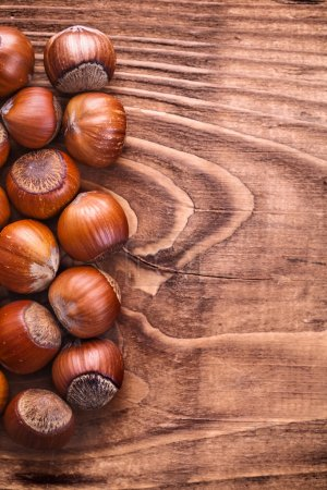 Hazelnuts on vintage wooden board