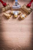 Brass Pipe Connectors On Wooden Board