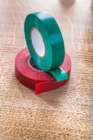 Rolls of insulating tape on wooden board
