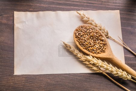 Wooden spoon with coens of wheat
