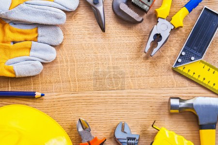Set of working tools on wooden board