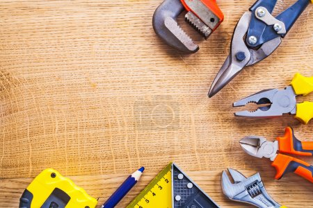 Set of tools on wooden board