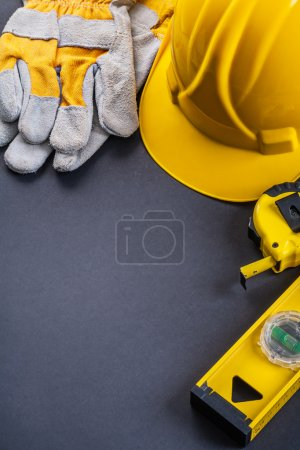 Protective gloves, helmet,  level tools