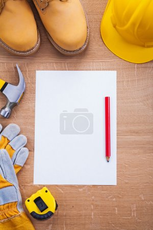 Tools with blank  paper and pencil