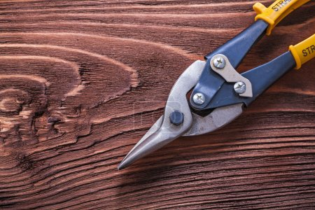 Photo for Metal nippers on wooden vintage board construction concept - Royalty Free Image
