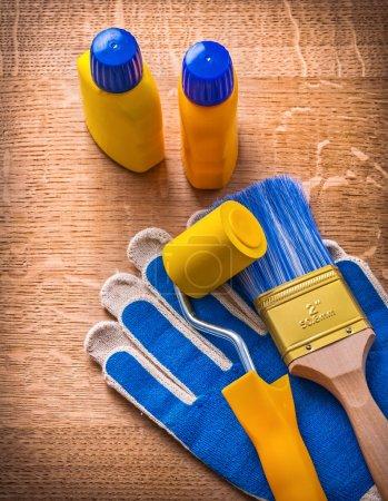 Paint roller, bottles, brush,  gloves