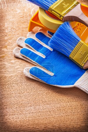 Paint tray brushes duct tape and protective gloves