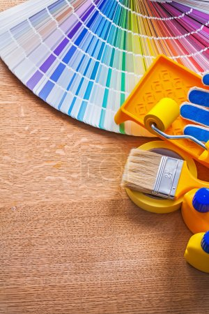 Set of paint tools and pantone color palette guide on wooden boa