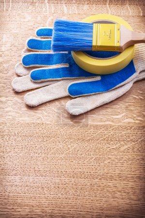 household tape, paint brush, gloves