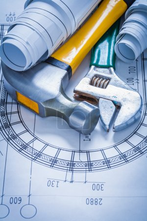 spanner, construction plans and claw hammer