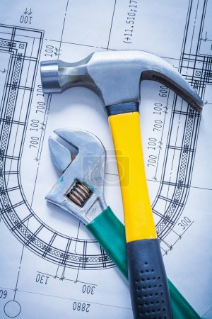 Photo for Claw hammer, adjustable spanner on construction drawing building and architecture concept - Royalty Free Image