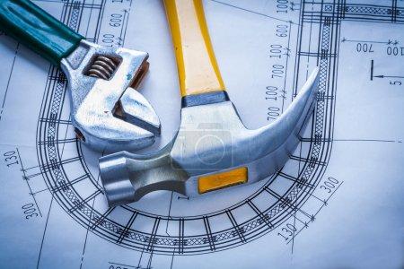 Claw hammer, adjustable spanner on blueprint