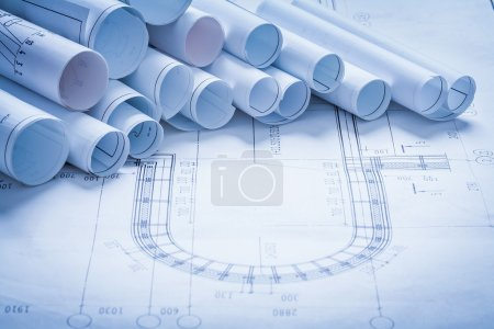Heap of rolled up construction drawings