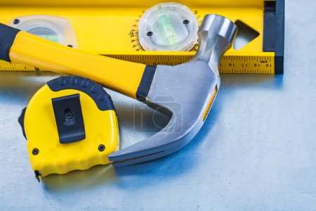 Construction tools on metallic background