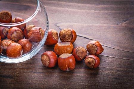 stack of hazelnuts in glass jar