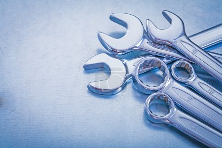Photo for Steel open-end wrenches and flat spanners on metallic background construction concept - Royalty Free Image
