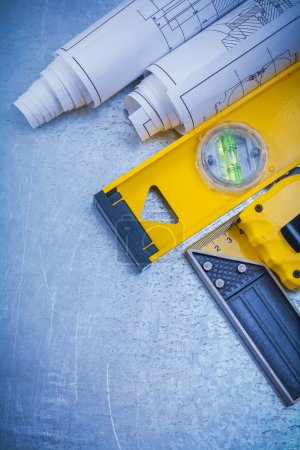 construction plans and level tape measure