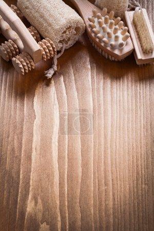 peeling massagers on pine vintage board